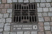 Information on a manhole cover in Villers-sur-Mer, Normandy, France