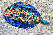 iSimangaliso Wetland Park. Sculpture of a turtle made with plastic caps and others rubish found on the beaches of the national park where the sea turtles are coming to hatch their eggs. Santa Lucia. Kwazulu Natal. South Africa.