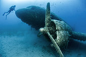 Diver in front of the wreck of a Dakota DC3 plane sunk into a dive site, Kas-Kekova Marine Protected Area, Turkey