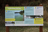 Information panel concerning the presence of cyanobacteria in the Rance river in Saint-Samson-Sur-Rance, Brittany, France