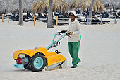 Mechanical cleaning of a beach in a Punta Cana hotel to rid it of cigarette butts. Dominican Republic.