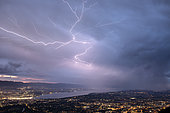 Thunderstorm of July 25, 2019 in Geneva. Lightning crawling on the sides of a cumulonimbus overlooking Geneva. Shooting from Mont Salève. Haute-Savoie, France