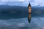 Bell tower of Curon (Graun), at Resia Lake, at dusk, Trentino-Alto Adige, Italy