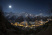 View of Mont-Blanc and the Aiguille du Midi, above the town of Les Houches, in the moonlight. Top right constellation of Orion. Haute-Savoie, France