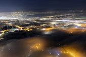 Stratus above Geneva, December 12, 2019. Atmospheric and light pollution over Geneva and its suburbs. Shooting from Mont Salève, Haute-Savoie; France