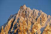Aiguille du Midi and its cable car, at sunset, February 06, 2020. Shooting from Les Houches, Haute-Savoie, France