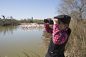 Léa, 8 years old, observing the birds in the Ornithological Park of the Pont de Gau, (MUST BE MENTION), Saintes-maries-de-la-mer, Camargue,France