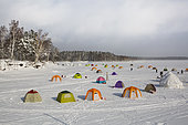 Fisherman's tent on frozen Shumarinai lake in Hokkaido, Japan