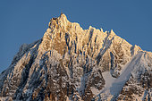 Last lights of the day on the Aiguille du Midi, Mont-Blanc Massif. Shooting from Les Houches, Haute-Savoie, France, February 06, 2020