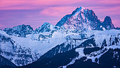 Aiguille Verte and the Drus at dusk. Shooting February 2020. In the foreground of the panorama, on the right, we can see the Club Med of Samoëns. Haute-Savoie, Franc