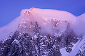 Aiguille du Midi in the stratus at dusk. Shot of February 2020, from Les Houches, Haute-Savoie, France
