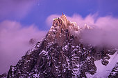 Aiguille du Midi and stratus at dusk. Shot of February 2020, from Les Houches, Haute-Savoie, France