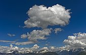 Cumulus clouds over mountain range, French Alps, Mont Blanc massif, Haute Savoie, France, Europe