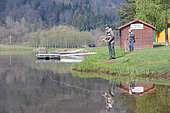 Fly fishing in a reservoir, Moselle, Lorraine, France