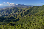 Landscape of the Anaga peninsula, on the island of Tenerife in the Canaries. on the horizon, the Teide volcano - The high slopes of the ravines are covered with Lauraceae forests - Parque Rural de Anaga - Tenerife - Canary Islands