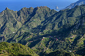 Landscape of the Anaga peninsula, on the island of Tenerife in the Canaries. Characteristic ravine relief - in the background the protected islet of Roques de Anaga - Parque Rural de Anaga - Tenerife - Canary Islands