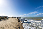 Beach cabins invaded by the sea, during high tides, Sangatte, Pas de Calais, France