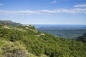 Gourdon, labeled The Most Beautiful Villages of France, the coast of the Côte d'Azur in the background, Préalpes d'Azur Regional Natural Park, Alpes-Maritimes, France