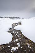 Aubrac plateau, Lac des Moines frozen by ice, Aubrac regional natural park, Lozère, France