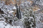 Chapel of Notre-Dame de Beauvoir from the 13th century during a snowfall, Moustiers-Sainte-Marie, labeled Les Plus Beaux Villages de France, regional natural park of Verdon, Alpes-de-Haute-Provence, France