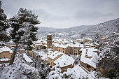 The village and the Notre-Dame-de-l'Assomption church during a snowfall, Moustiers-Sainte-Marie, labeled Les Plus Beaux Villages de France, regional natural park of Verdon, Alpes-de-Haute-Provence, France