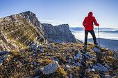 Cliff of the Rocher des deux soeurs (2173m), panorama of the Valbonnais and Oisans from the Col des Moucherolles (2060m), Le Trièves, Hauts Plateaux du Vercors national nature reserve, Vercors regional natural park, Isère, France