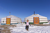 Yurt in the snow with a child, Altai mountains, West Mongolia, Mongolia