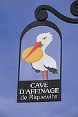 Sign of a ripening cheese maker, stork with a cheese in its beak, rue, Riquewihr, Haut Rhin, France