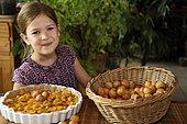 Little girl, 6 years old, preparing mirabelle plum tart, cooking, Belfort, France