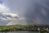 Thunderstorm and rainbow over Seyssel, Haute Savoie, France