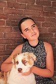 Australian Shepherd puppy and girl