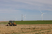 Scumming tractor and wind turbines, North of France