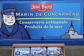 Poster and boxes of the Jean Burel cannery, Marin de Concarneau, shop, village labeled Les Plus Beaux Villages de France, Locronan, Finistère, France