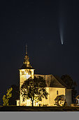 Comet Neowise, meteorite, and Notre-Dame-de-l'Assomption church of Mont-Saxonnex, Haute-Savoie, July 13, 2020 in the late night, France