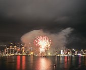 Fireworks over the skyline of Victoria Island, view from Kowloon, night scene, Central District, Hong Kong, Hong Kong Island, Hong kong, China, People's Republic of China, Asia