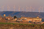 Wind turbines overlooking the village and nature reserve of Montmesa, Huesca, Aragon, Spain