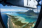 Aerial view of Bora-Bora through a porthole, French Polynesia