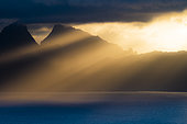 Island of Moorea in the sunset and rays of light, French Polynesia