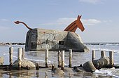 Art at a bunker, bunker from World War II decorated as a mule on the beach of Blavand, Jutland, Denmark, Europe