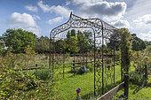 Metal arbor in a garden in summer, Pas-de-Calais, France