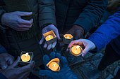 Hands holding devotional candles at dusk, Bavaria, Germany, Europe