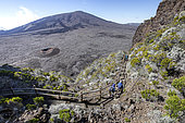 People walking on the trail to the Piton de la Fournaise, one of the most active volcanoes on the planet, Réunion, overseas department and region of the French Republic and an Indian Ocean island in East Africa