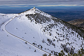 The Radome and the Route du Mont Serein in the limestone scree on the northern slope of the summit of Mont Ventoux in snow, Vaucluse 84, Provence-Alpes-Cote d'Azur, France