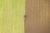 Ploughing a field seen from the sky in autumn, Pas-de-Calais, Opal coast, France