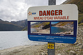 Sign indicating the danger of rising water from the Grand 'Maison dam installed on the Savoie side, France