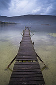 Jetty on Aiguebelette lake at dusk, Savoie, France