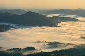 From the top of the Oylarandoy, view of the sunrise over the sea of clouds covering St Jean-Pied-De-Port, Pyrenees, Basque Country, France