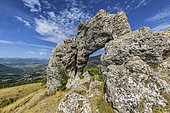 The Pierced Stone, in Matheysine, Famous natural arch formed of eroded cargneule, Isère, France