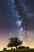 Saturn, Jupiter and the Milky Way over the Jura. Constellation of Sagittarius, and Scorpio on the right, with the star Antares, Crêtes du Grand Colombier, South of the Jura massif, France