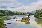 Wooden house on rocks in the river Drina, Banja Basta, Serbia, Europe